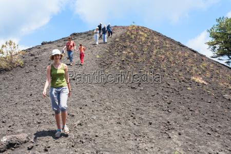 tourists walk on ridge of old