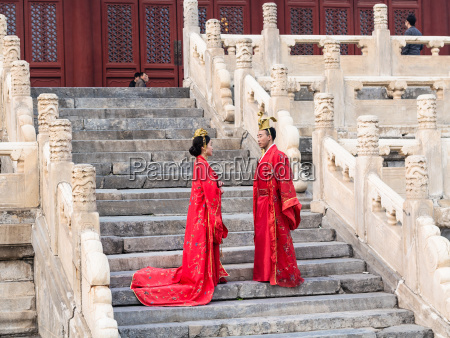 couple in traditional costumes on steps