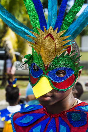 boy in a carnival costume at