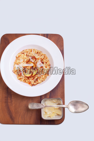 mushroom risotto with a spoon