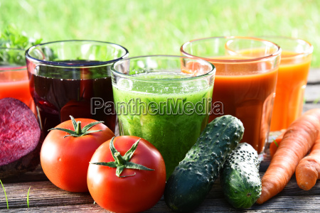 glasses with fresh organic detox juices